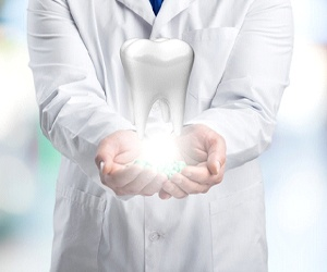 A man and woman shaking the hand of a dental office staff member