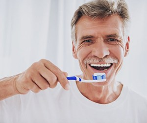 older man about to brush his teeth