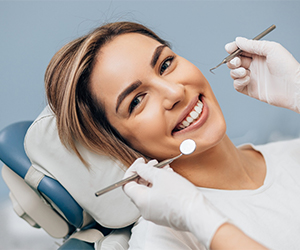 A female patient smiling in the dentist's chair