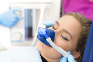 Woman wearing dental sedation mask